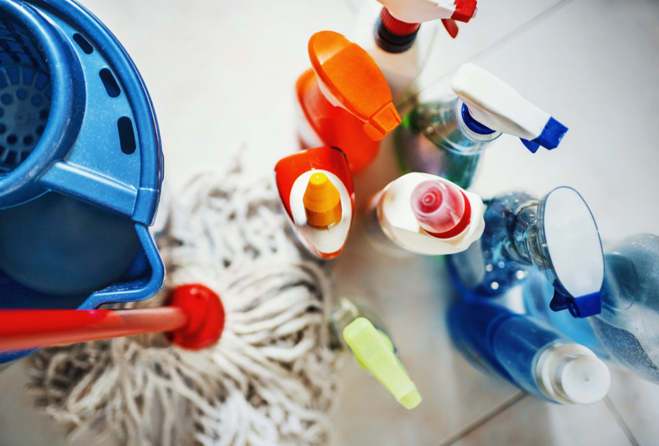 Closeup top view of unrecognizable home cleaning products
